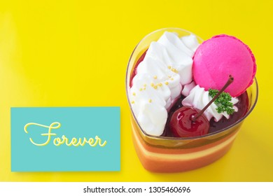 Colorful strawberry cake and macaron on colorful bright background and lovely card - love with cake and ecard concept