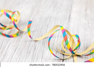 colorful streamer on a wooden background