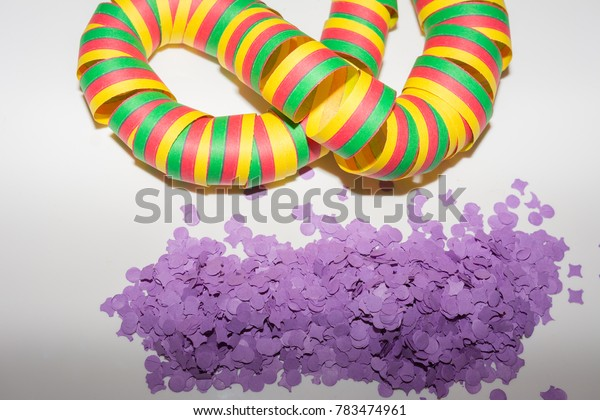 Colorful streamer with pink confetti on white background
