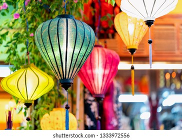 Colorful street lamps hanging at market in Hoi An old city in Southeast Asia in Vietnam. Light decorations at shop as Vietnamese ancient culture and tradition. Traditional lamps in Hoian