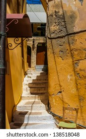 Colorful street with staircase and traditional architecture on island of Crete in Chania, Greece