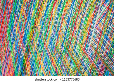 Colorful strings in close up - an abstract background