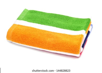 a colorful striped beach towel on a white background