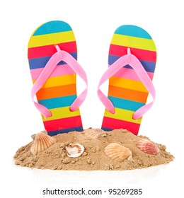 Colorful striped flip flops at the summer beach