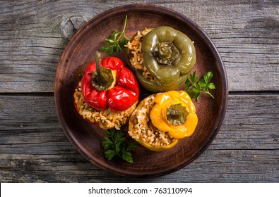 Colorful stuffed peppers with rice , meat and parsley