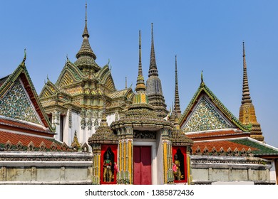 Colorful stupas in Wat Pho Temple in the city of Bangkok in Thailand