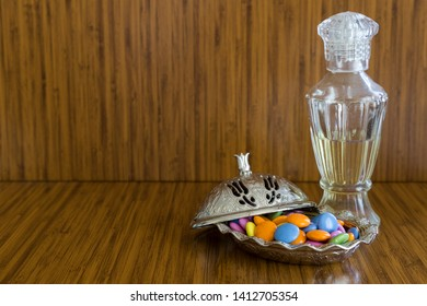 colorful sugars,almonds,cologne and candies in the plate for Muslim Ramadan feast.