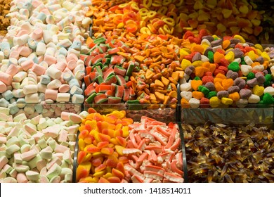 colorful sugars,jelly tots and candies in the plate for Muslim Ramadan feast.