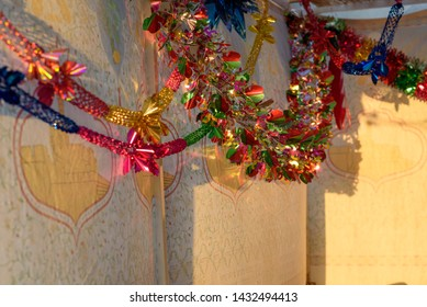 Colorful Sukkah decoration shiny garland at sunset light.Selective focus.