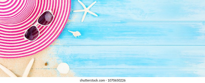 Colorful summer holiday beach banner background with accessories on light blue wood panel, border design on top view with copy space