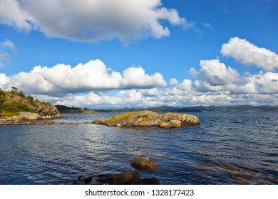 Colorful summer landscape with sea and mountains in Norway.