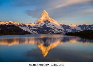 Colorful summer panorama of the Matterhorn pyramid and Stellisee lake. Few minutes before sunrise. Great june outdoor scene in Swiss Alps, Zermatt, Switzerland, Europe