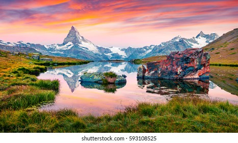Colorful summer panorama of the Stellisee lake. Few minutes before sunrise. Great outdoor scene with Matterhorn (Monte Cervino, Mont Cervin) in Swiss Alps, Switzerland, Europe.