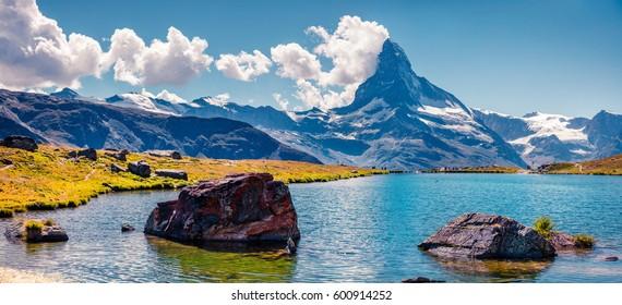 Colorful summer panorama of the Stellisee lake. Great outdoor scene with Matterhorn (Monte Cervino, Mont Cervin) in Swiss Alps, Zermatt location, Valais canton, Switzerland, Europe.