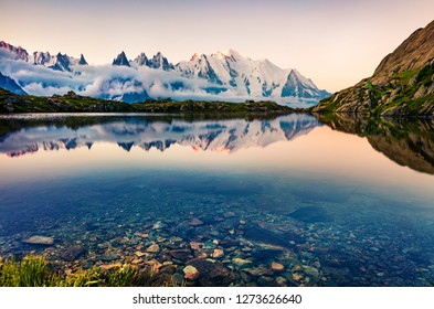 Colorful summer scene of Lac Blanc lake with Mont Blanc (Monte Bianco) on background, Chamonix location. Beautiful evening view of Vallon de Berard Nature Preserve, Graian Alps, France, Europe.
