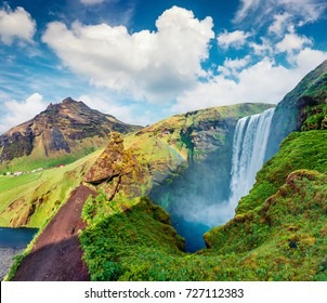 Colorful summer scene with pure water of Skogafoss Waterfall. Sunny morning on the Skoga river, south of Iceland, Europe. Beauty of nature concept background.