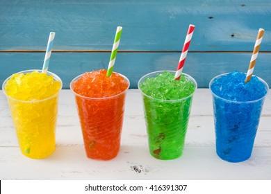 Colorful summer slushies on blue background