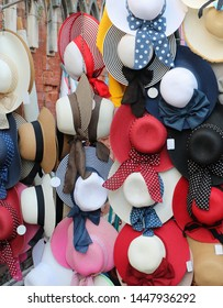 Colorful summer straw hats with ribons and bows sold on market
