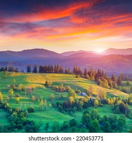 Colorful summer sunrise in the mountain village.
