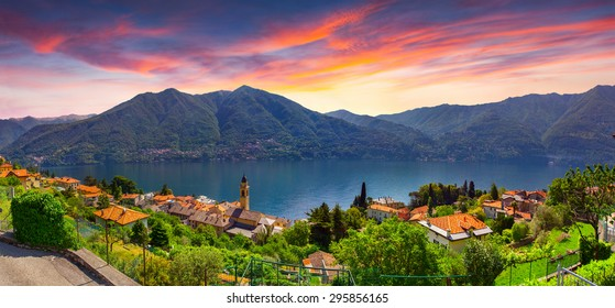 Colorful summer sunrise on the town of Carate Urio, on Lake Como. Alps, Italy, Lombardi, Europe.