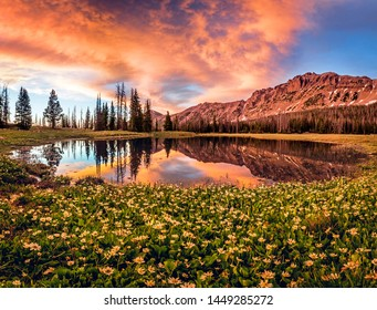 Colorful summer sunset reflection in the Uinta Mountains, Utah, USA.
