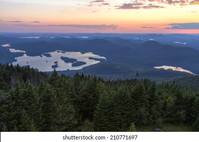Colorful summer sunset view from the Blue Mountain Fire Tower in the Adirondacks Mountains of New York