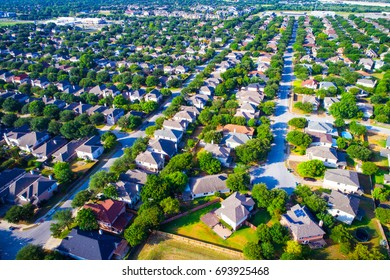 Colorful summer time aerial drone view of Austin Texas USA suburb homes in vast distance home after home near wells branch