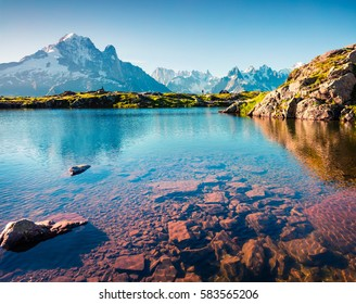 Colorful summer view of Lac Blanc lake with Mont Blanc (Monte Bianco) on background, Chamonix location. Beautiful outdoor scene in Vallon de Berard Nature Reserve, Graian Alps, France, Europe.