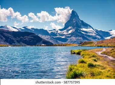 Colorful summer view of the Stellisee lake. Great outdoor scene with Matterhorn (Monte Cervino, Mont Cervin) in Swiss Alps, Zermatt location, Valais canton, Switzerland, Europe.
