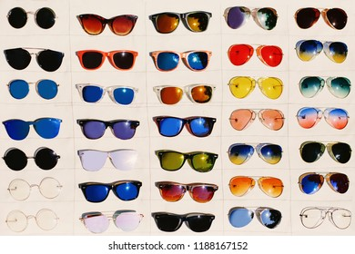 Colorful sunglass assortment on white background