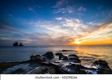 colorful sunrise of candle stick shaped rocks at north coast Taipei Taiwan