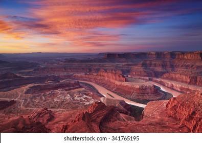 Colorful sunrise at Dead Horse Point, Colorado river, Utah, USA