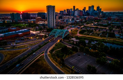 Colorful Sunrise in Denver , Colorado Aerial drone view of the Modern Skyline Cityscape growing in the Mile High City bridges connecting the city