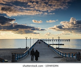 Colorful sunrise at a famous marine pier in Palanga, Lithuania, Europe