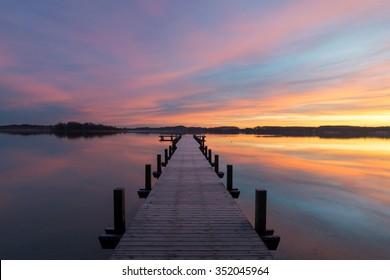 Colorful sunrise at lake Woerthsee in Bavaria, Germany