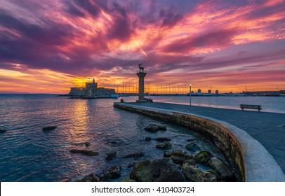 Colorful sunrise in Mandaki Harbor Rhodes, Greece