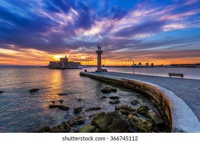 Colorful sunrise in Mandraki harbor Rhodes, Greece