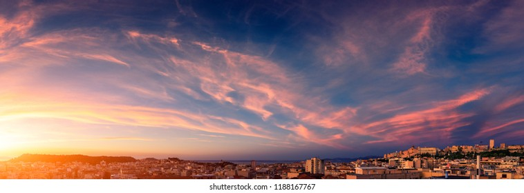 Colorful sunrise on the city. Panoramic view of Cagliari city at sunrise with colorful sky.