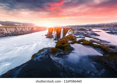 Colorful sunrise on Famous Selfoss waterfall, Jokulsargljufur National Park, Iceland