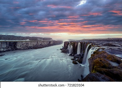 Colorful sunrise on Famous Selfoss waterfall, Jokulsargljufur National Park, Iceland. Landscape photography