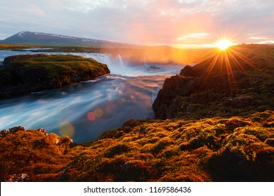 Colorful sunrise on Godafoss waterfall on Skjalfandafljot river, Iceland, Europe