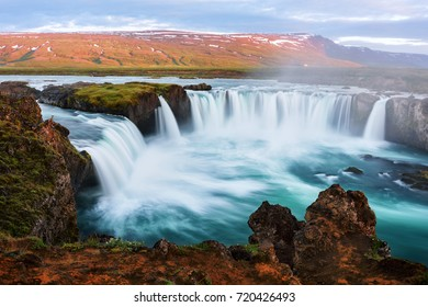 Colorful sunrise on Godafoss waterfall on Skjalfandafljot river, Iceland, Europe. Landscape photography