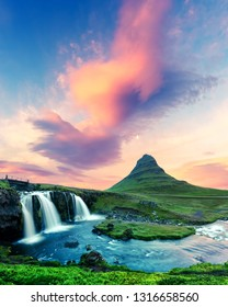 Colorful sunrise on Kirkjufellsfoss waterfall. Amazing morning scene near Kirkjufell volkano, Iceland