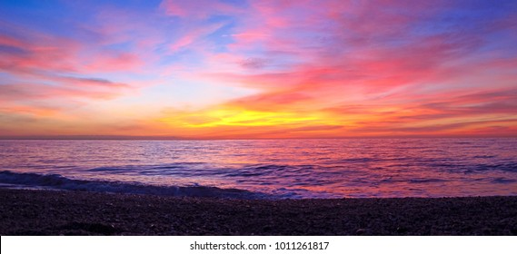 Colorful sunrise over the beach in the mediterranean sea in the south coast of Spain