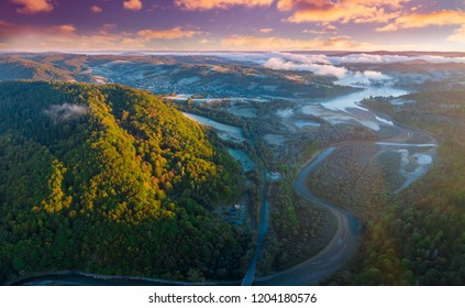 Colorful sunrise over Bieszczady mountains and Solinka river - aerial, drone photography.