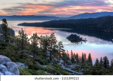 Colorful sunrise over Emerald Bay and Eagle Point off Lake Tahoe in California.