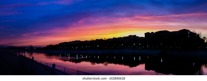 Colorful sunrise over the homes along Ballona Creek in Playa Vista, California
