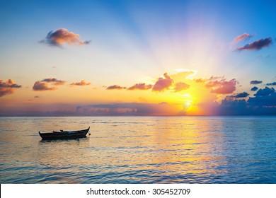 Colorful sunrise over ocean on Maldives