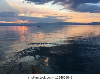 Colorful sunrise over pier with boats at Lake Tahoe in California, United States