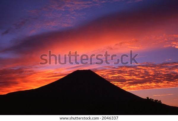 Colorful sunrise over the silhouette of Mount Fuji